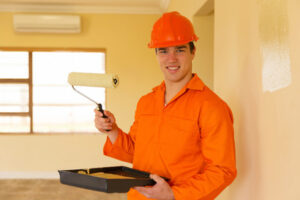 A professional painting contractor working in a unit in Windsor, ON