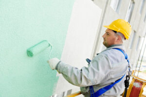 A skilled painting contractor painting a commercial place in Windsor, ON