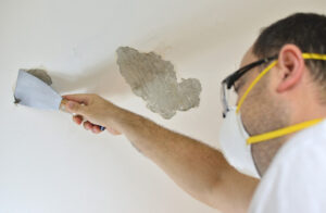 A ceiling being repaired by a skillful handyman in Windsor, ON