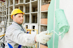 A skillful painting contractor painting a commercial space in Windsor, ON