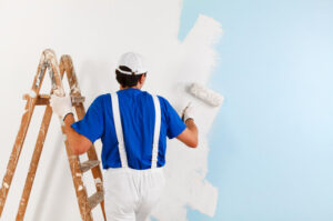 A skilled painting contractor working in a residential area in Windsor, ON